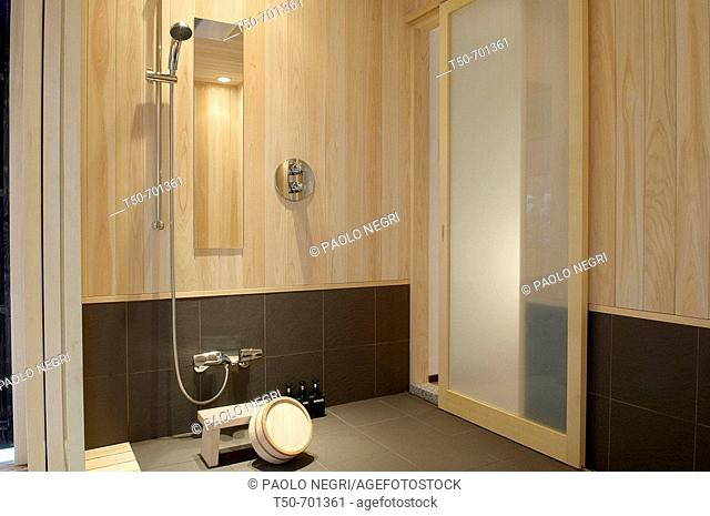 Japan, home interior, shower with wooden tube and chair