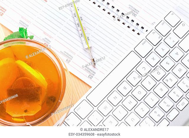 Lemon Tea with mercury thermometer and computer keyboard