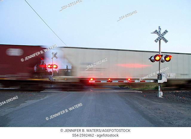 A train at a railroad crossing in the evening in eastern Washington State, USA