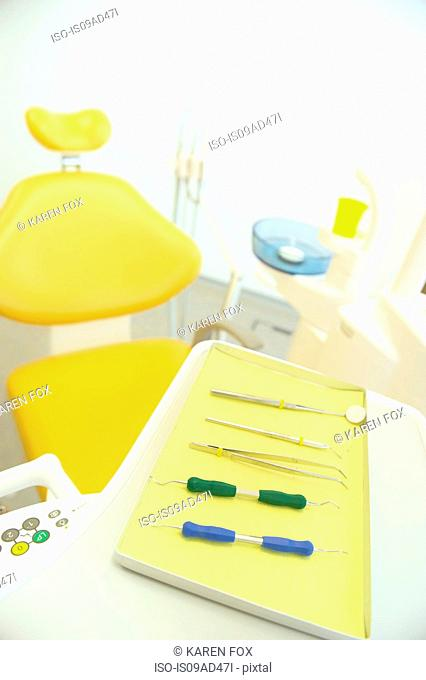 Dental chair and surgical tray in clinic