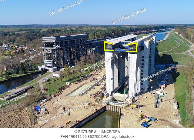 15 April 2019, Brandenburg, Niederfinow: View of the construction site of the new ship's hoist (r) and of the old hoist, aerial view with a drone