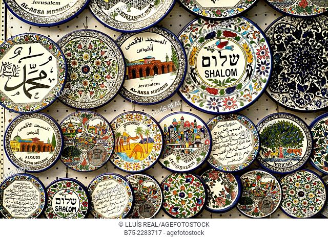 Wall in a souvenir shop hanging plates with allusions to Jerusalem, Israel