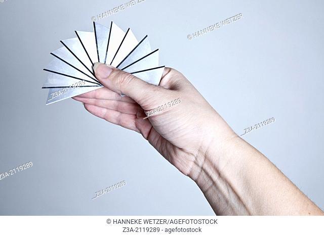 Hand holding razor blades