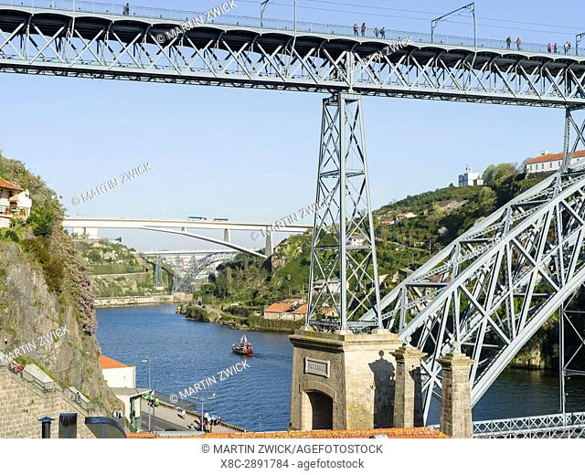 The bridge Ponte Dom Luis I . City Porto (Oporto) at Rio Douro in the north of Portugal. The old town is listed as UNESCO world heritage