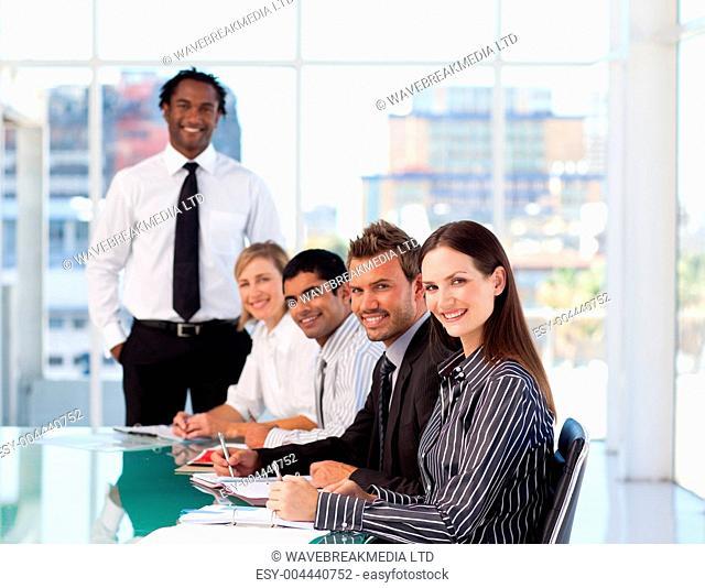 Confident businesswoman attending a presentation