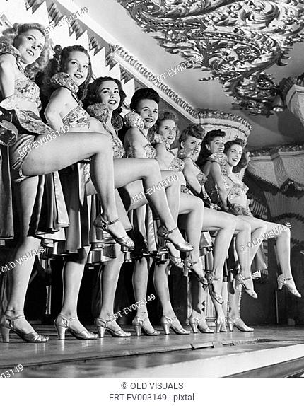 Chorus line of women with legs lifted All persons depicted are not longer living and no estate exists Supplier warranties that there will be no model release...