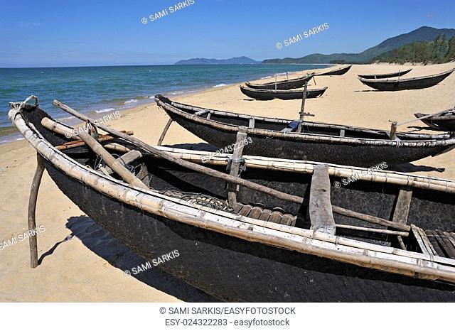Traditional fishing boats on Vinh Hien beach, near Hue, Vietnam, Southeast Asia