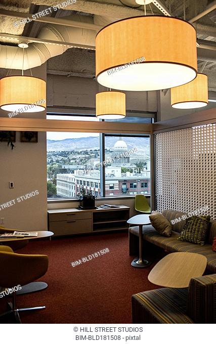 Sofas in modern office lobby