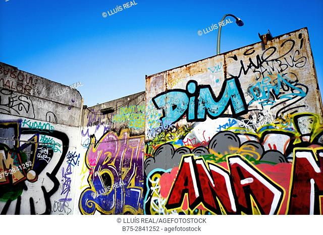 Graffiti on wall and street lamp. Berlin, Germany
