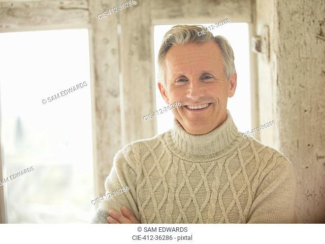 Portrait smiling senior man in turtleneck sweater