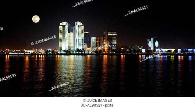 Skyline of Doha at night, capital city of Qatar, United Arab Emirates
