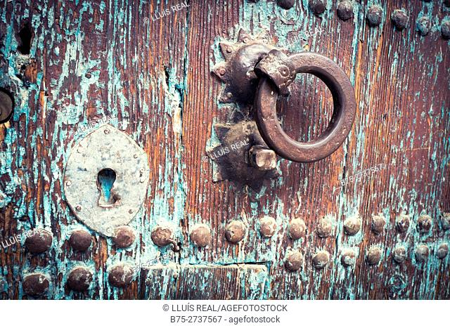Antique wooden door with keyhole and doorknocker. Chaouen, Morocco