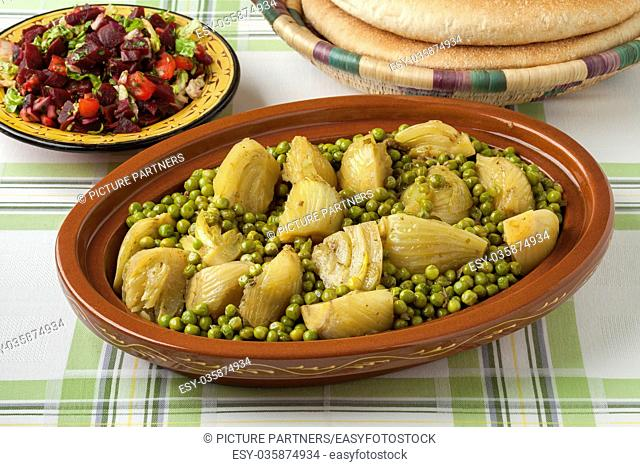 Traditional Moroccan tagine with meat, peas, fennel , beet salad and bread