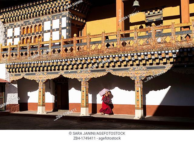 A buddhist monk carrying provisions at Punakha Dzong, Punakha, Bhutan, Asia