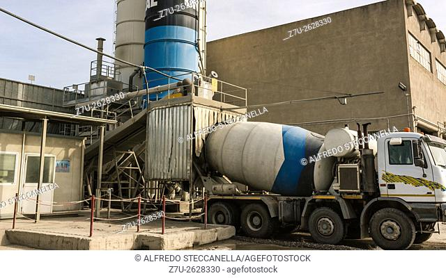 Catania - Sicily - Industrial area: The trucks waiting to load cement from silos