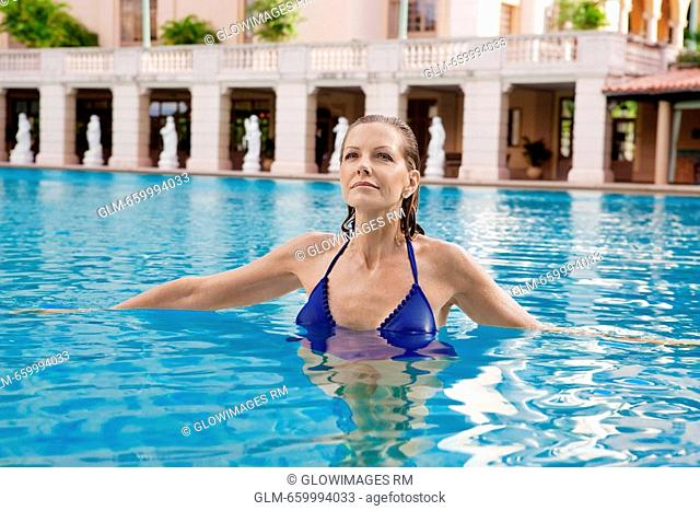 Woman in a swimming pool, Biltmore Hotel, Coral Gables, Florida, USA