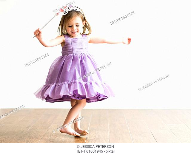 Girl (4-5) in princess costume dancing