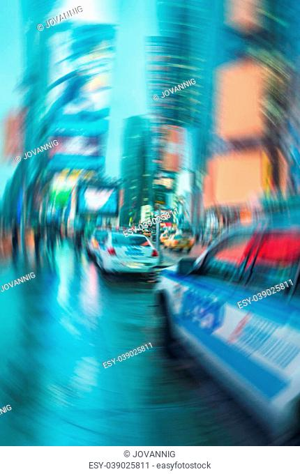 Blurred picture of New York police car in Times Square at night