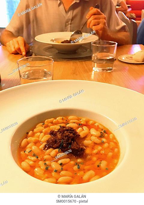 Pochas serving in a restaurant. Spain