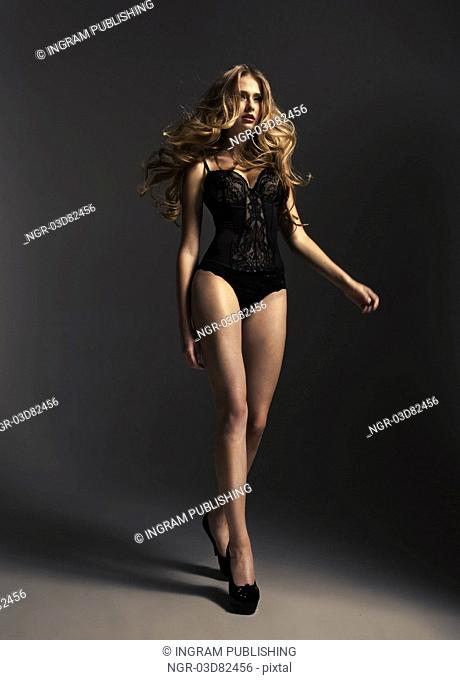 Tall alluring woman wearing sexy lingerie