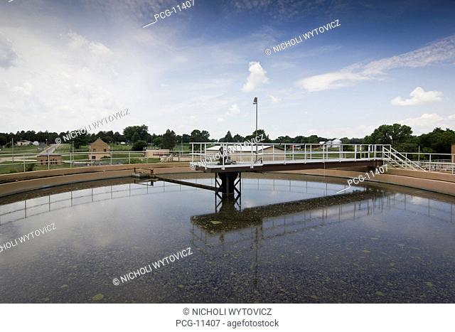 A circular cleaning system with a raised platform over a Waste Water Treatment System