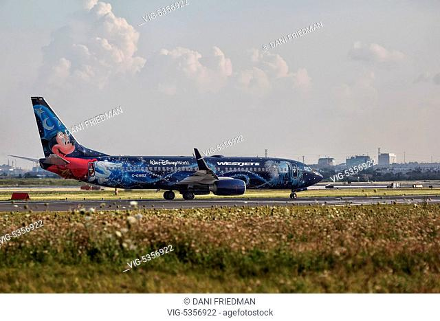CANADA, MISSISSAUGA, 15.08.2015, A Westjet Airlines Boeing 737-8CT airplane painted in the special 'Magic Plane' scheme of Walt Disney World preparing to...
