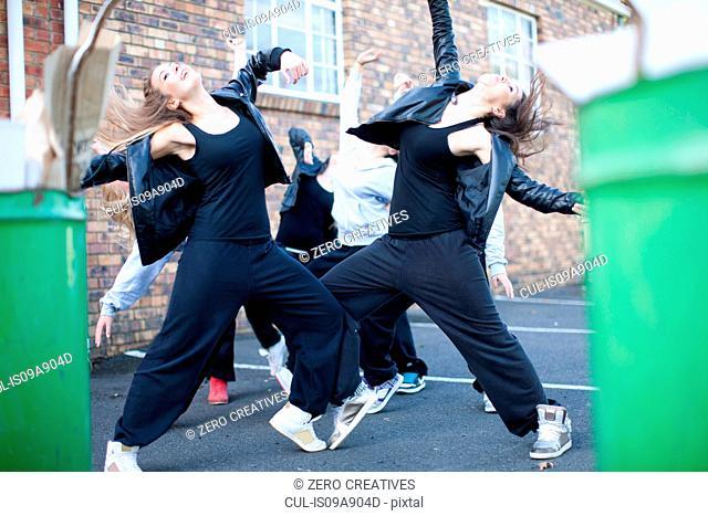 Group of girls dancing in carpark