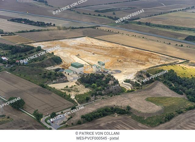 Germany, Quedlinburg, aerial view of quartz sand pit in the evening