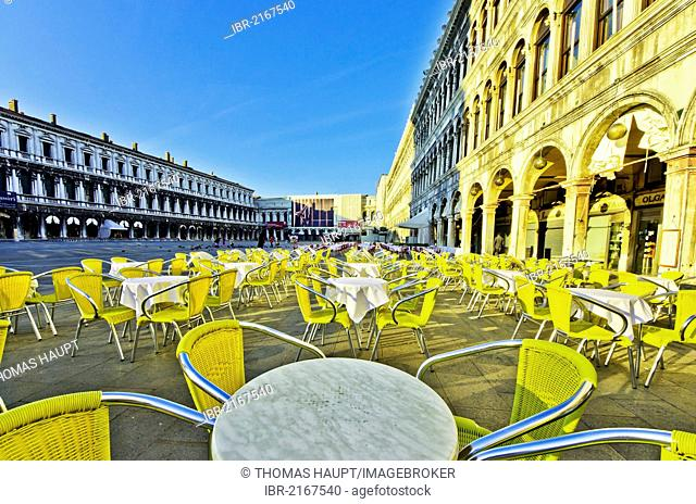 Chairs and tables outside the Cafe Quadri, Piazza San Marco, St. Mark's Square, Venice, Venezia, Veneto, Italy, Europe
