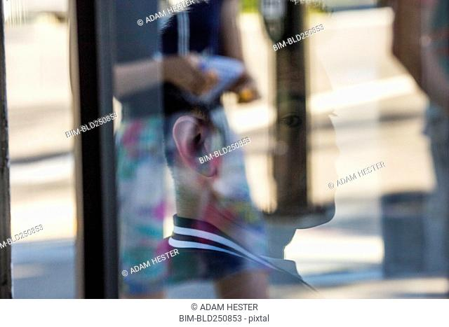 Serious Chinese man behind window