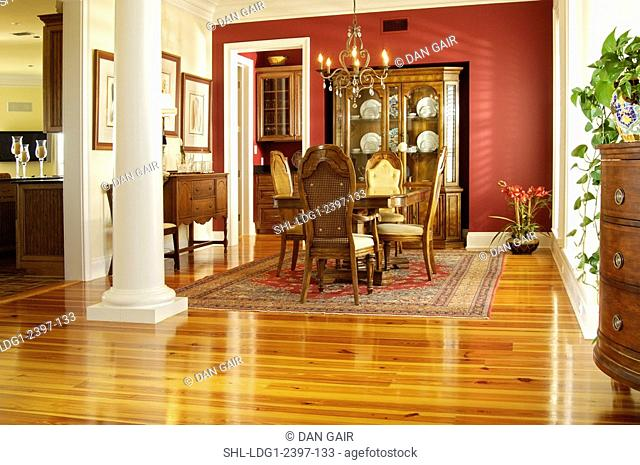 Traditional Dining room with high back chairs and heart pine hardwood floors