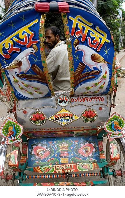Cycle Rickshaw art-Bangladeshis unique and popular arts  ;the paintings and decoration on the three wheeler cycle rickshaw ; Dhaka ; Bangladesh
