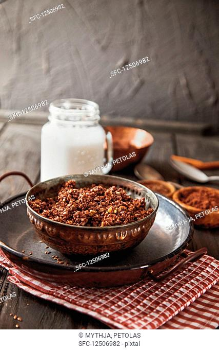 Healthy breakfast granola with cocoa and almond milk