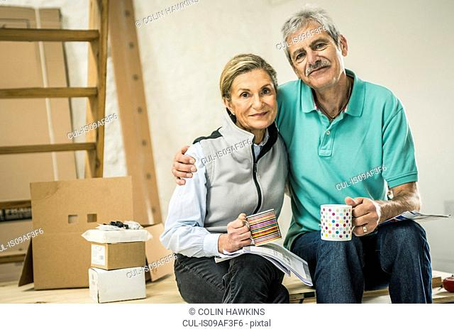 Senior couple taking coffee break
