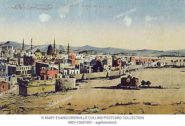 Medina, Saudi Arabia - Panoramic View, featuring the old city walls and a distant view of the Al-Masjid al-Nabawi Mosque