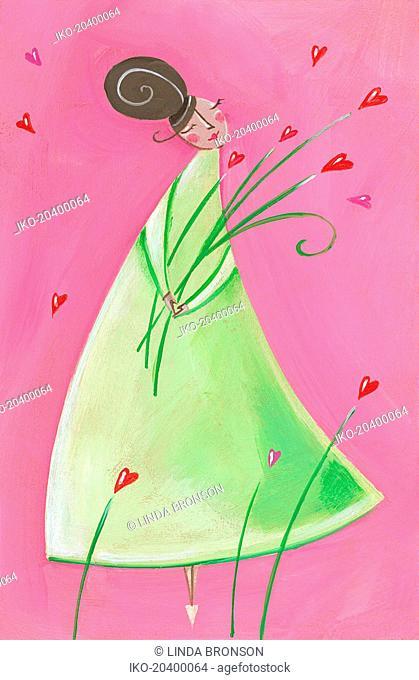 Woman holding heart-shape flowers