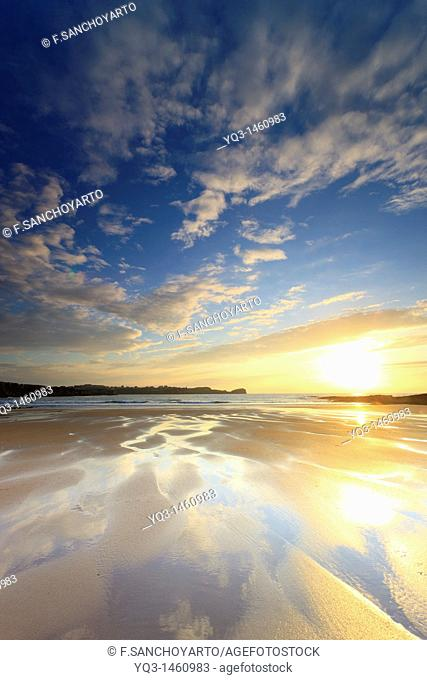 Reflections on the beach of Los Caballos, Miengo, Cantabria, Spain