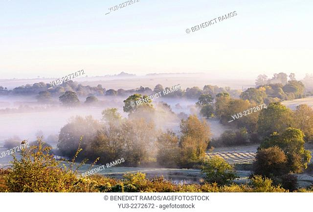 Sun breaking through on a misty autumn morning at Northbrook in the Cherwell valley Oxfordshire England UK
