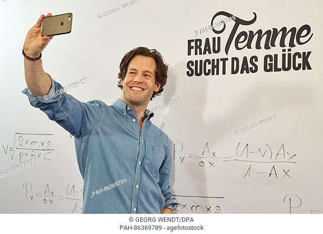 """The Swedish actor Richard Ulfsäter taking a selfie in front of a """"""""Frau Temme sucht die Glueck"""""""" banner during a press event for the new ARD prime time evening..."""