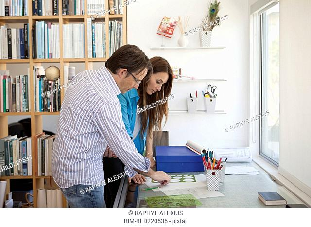 Couple working together in home office