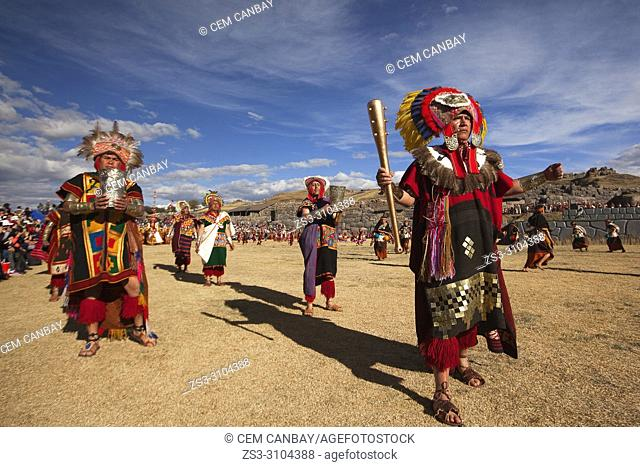 Indigenous people with traditional costumes during a performance at the Inti Raymi Festival in Saqsaywaman Archaeological Site, Cusco, Peru, South America