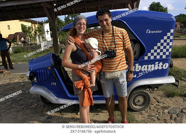 Caucasian family of tourist in a Cubanito, typical tuc-tuc transport in Trinidad, Cuba