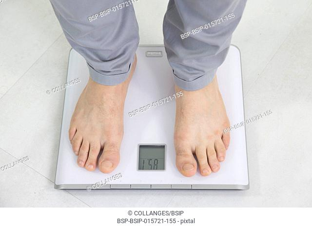 Man on weight scale