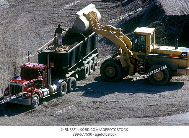 Construction: Truck & Bulldozer In Rock Quarry