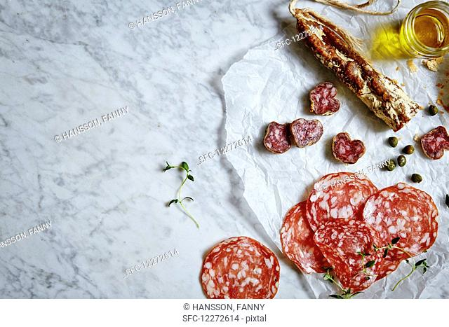 Fine meats and delicatessen. Served on a white marble
