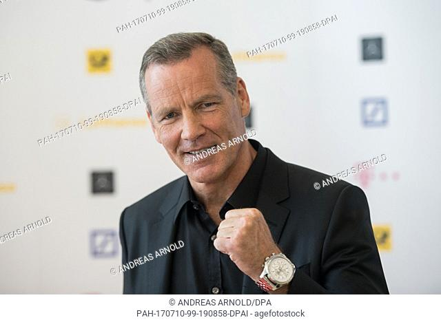 Former pro boxer Henry Maske standing in front of the sponsors wall of Deutsche Sporthilfe in Marburg, Germany, 10 July 2017
