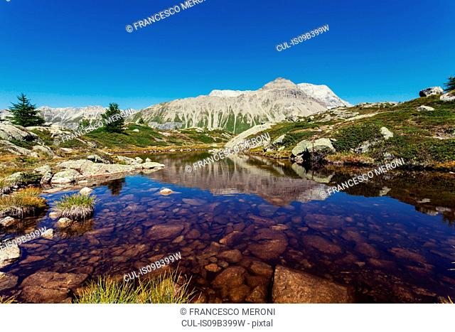 View of lake and mountains, Albula Pass, Graubunden, Switzerland