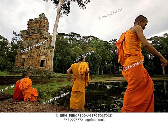 Buddhist Monk at the Temples of Kleangs & Prasat Suor Prat. Angkor Thom. Rectangular sandstone building set opposite the Terrace of Elephants