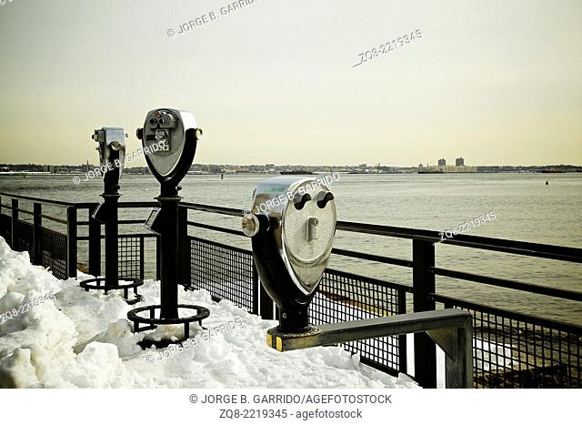 tourist binoculars at Liberty Island in front of Manhattan Skyline