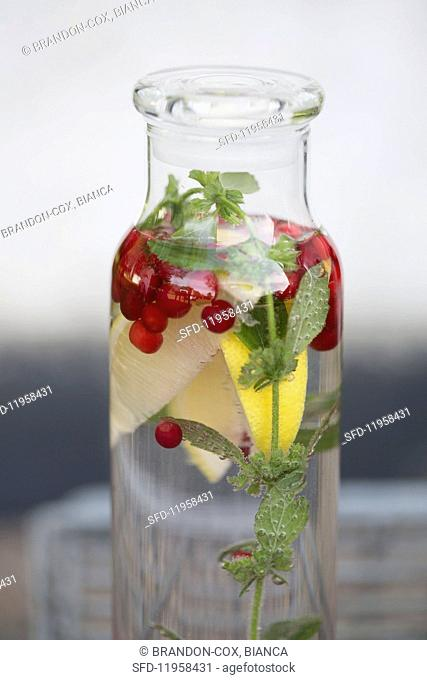 Flavoured water with lingonberries, peppermint and lemons